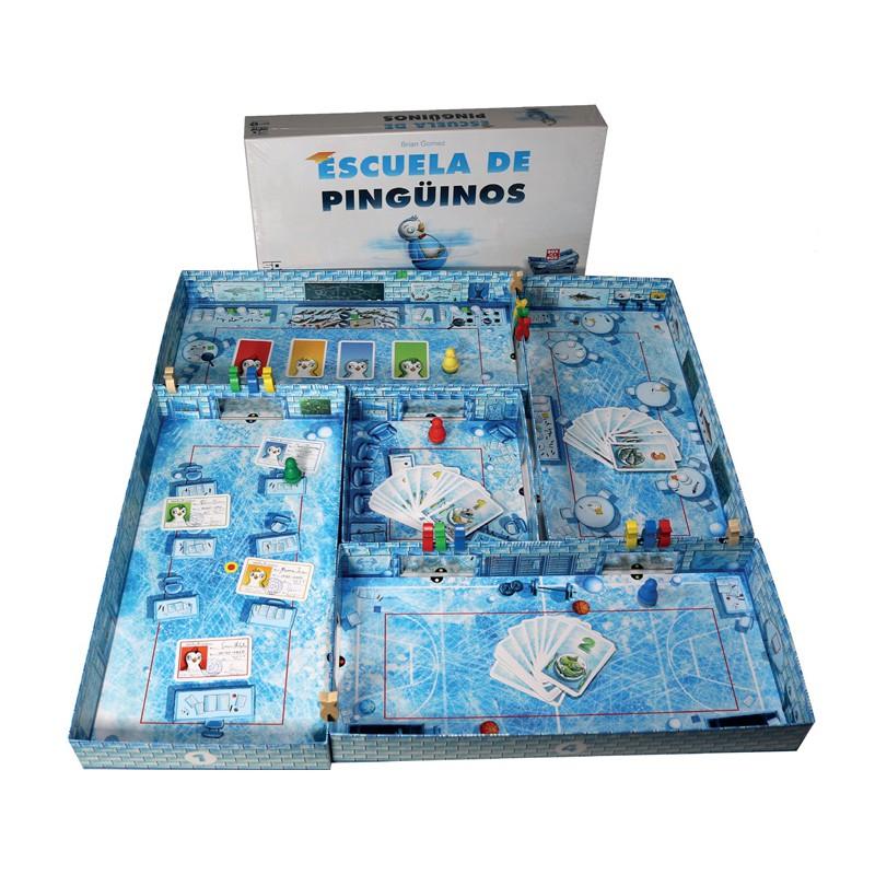 """Escuela de Pingüinos es un juego de mesa de habilidad mediante """"impulso con el dedo"""", en el que los jugadores representarán a traviesos pingüinos en busca de pescado intentando evitar al vigilante de la Escuela. Disponible para comprar en oferta en Lámpara Mágica Shop Sevilla."""